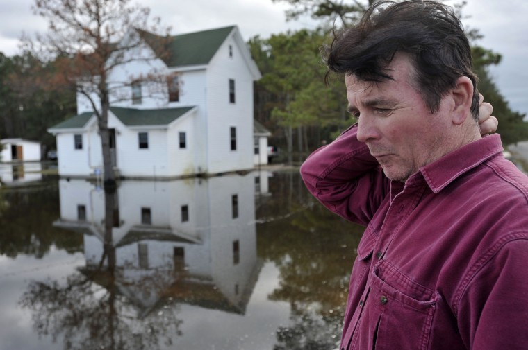 Gary Catlin, Fairmount, MD, talks about the damage his property sustained from tidewater that was pushed into his community by Superstorm Sandy. (Kim Hairston/Baltimore Sun)