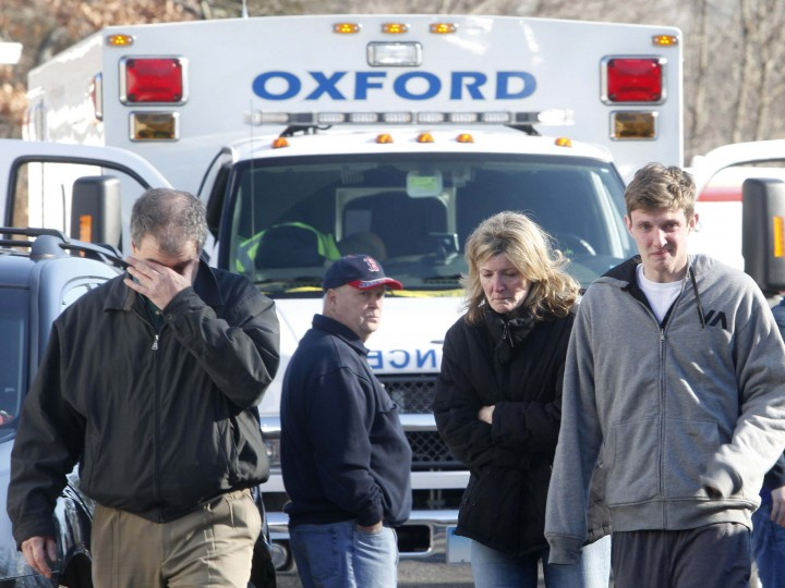 Relatives react outside Sandy Hook Elementary School following a shooting in Newtown, Connecticut. (Michelle McLoughlin/Reuters photo)