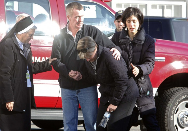 Relatives react outside Sandy Hook Elementary School following a shooting in Newtown, Connecticut2. At least 27 people, including 18 children, were killed on Friday when at least one shooter opened fire at an elementary school in Newtown, Connecticut, CBS News reported, citing unnamed officials. (Michelle McLoughlin/Reuters photo)