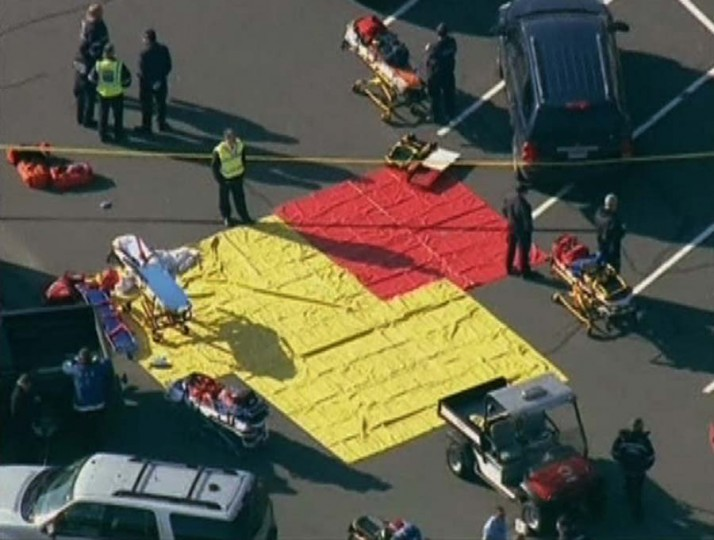 Emergency personnel set up in the parking lot after a shooting at Sandy Hook Elementary School in Newtown, Connecticut, December 14, 2012. (WNBC/via Reuters)