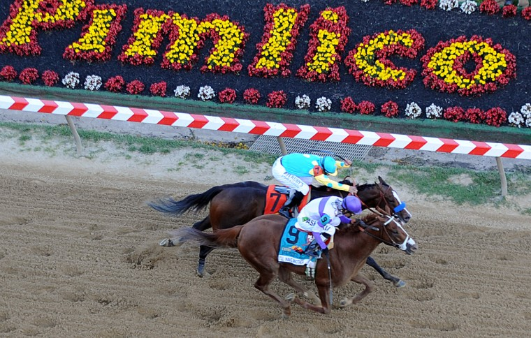 I'll Have Another (#9) overtakes Bodemeister (#7) in the final stretch to win the 137th Preakness Stakes. (Jerry Jackson/Baltimore Sun)