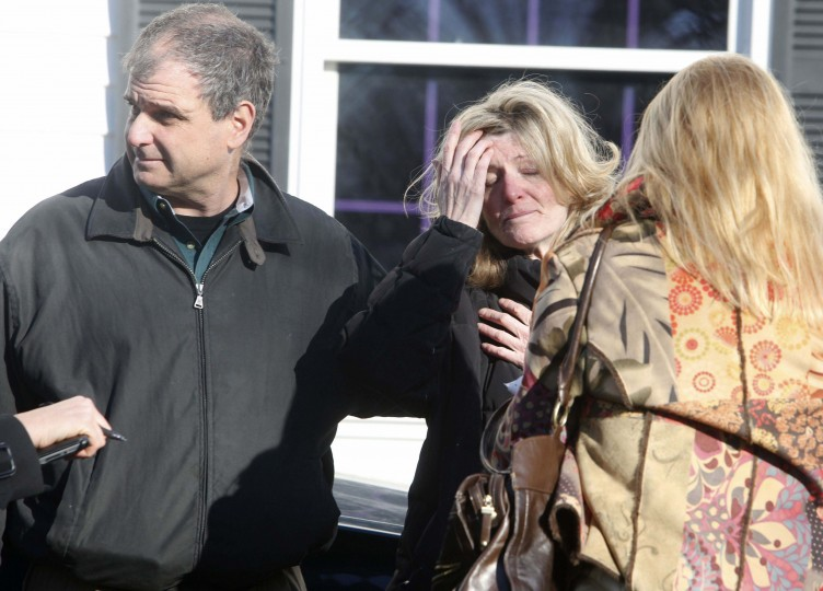 Relatives react outside Sandy Hook Elementary School following a shooting in Newtown, Connecticut. At least 27 people, including 18 children, were killed on Friday when at least one shooter opened fire at an elementary school in Newtown, Connecticut, CBS News reported, citing unnamed officials. (Michelle McLoughlin/Reuters photo)