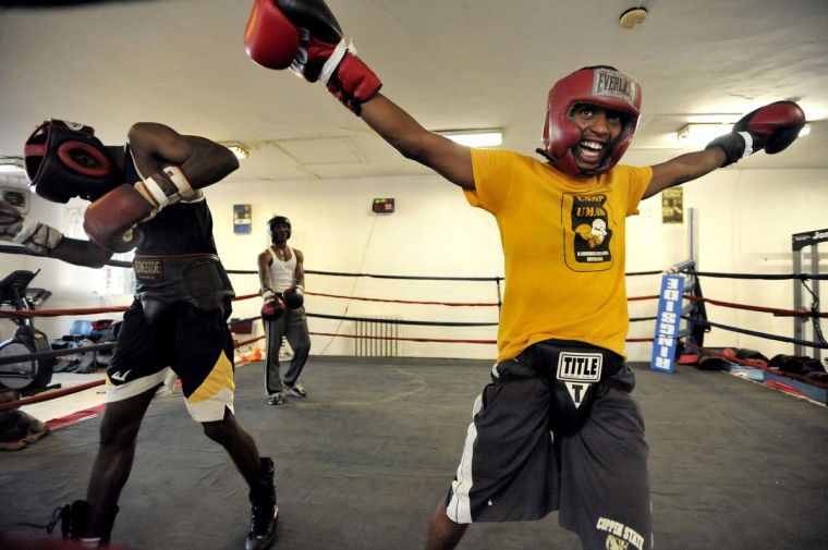 Left to right, Montell Bridgett, Marquise Pryor and Antwain Robinson, 18, dance as music plays before the bell signals the beginning of sparring. They are training at the UMAR Boxing Program, Inc. on North Avenue. (Kim Hairston/Baltimore Sun)