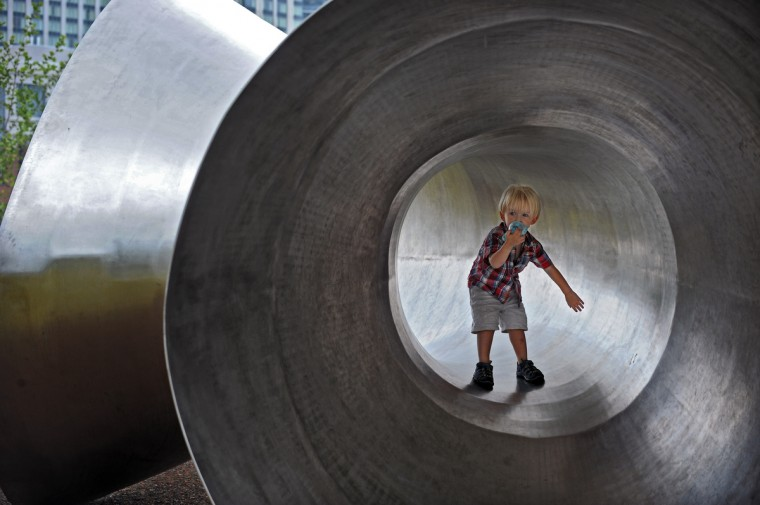 Baltimore City resident Joseph Wetherell, 2, enjoy the weather while playing in an outdoor sculpture at Pierce's Park near Pier Five of Inner Harbor. (Kenneth K. Lam/Baltimore Sun)