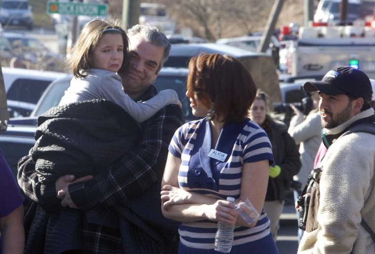Parents pick-up children outside Sandy Hook Elementary School after a shooting in Newtown, Connecticut. At least 27 people, including children, were killed on Friday when at least one shooter opened fire at the elementary school. (Michelle McLoughlin/Reuters photo)