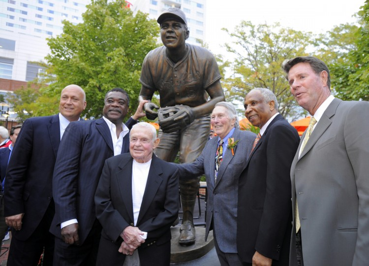 L-R Oriole Hall of Famers, Cal Ripken Jr. Eddie Murray, Earl Weaver, Brooks Robinson, Frank Robinson and Jim Palmer. The Baltimore Orioles unveil the Brooks Robinson statue at Camden Yards before an Orioles game against the Boston Red Sox. (Lloyd Fox, Baltimore Sun)