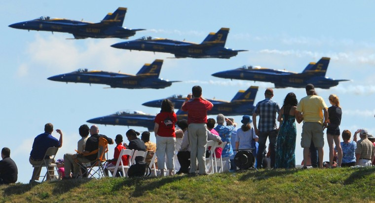 Spectators at Fort McHenry get a good view of the Navy's Blue Angels as they perform the Sailabration air show in June. (Jerry Jackson/Baltimore Sun)