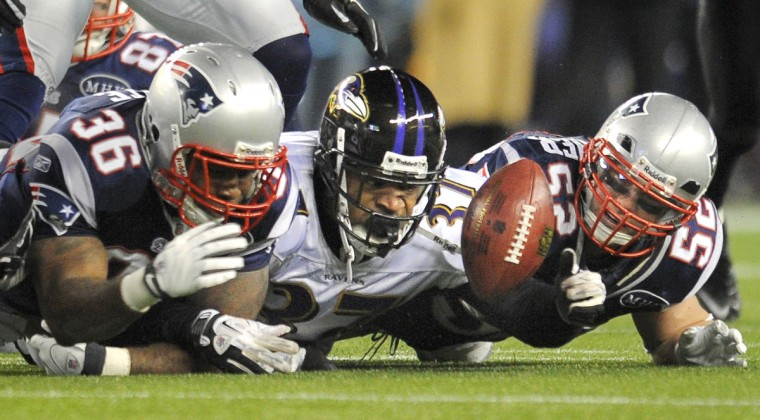 Ravens' #37 Emanuel Cook recovers a Patriots fumble on a kickoff, as Patriots' #36 Lousaka Polite (L) and #52 Dane Fletcher (R) can't come up with the ball in the third quarter. (Lloyd Fox/Baltimore Sun)