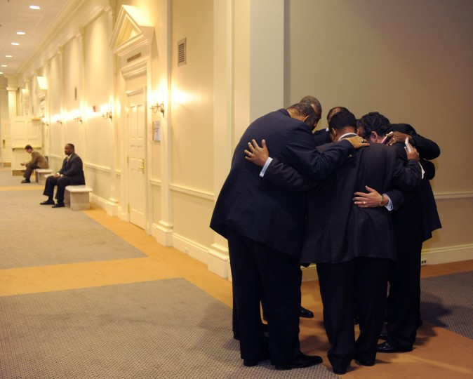 Clergy members from the Maryland Marriage Alliance gather together to say a prayer before holding a press conference regarding their opposition to the same sex marriage bill. The meeting was held in the House of Delegates office building. (Barbara Haddock Taylor/Baltimore Sun)