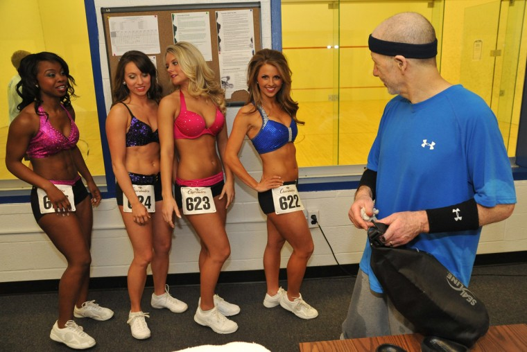 After playing racquetball, Bert Van Court, right, discovers a few cheerleader candidates waiting for their tryouts in the hallway of the Downtown Athletic Club. A record 312 hopefuls came to Saturday's tryouts to become Ravens cheerleaders. Finalists will compete in the final round of tryouts later this month for the final 60 spots - 20 male and 40 female cheerleaders. (Amy Davis/Baltimore Sun)