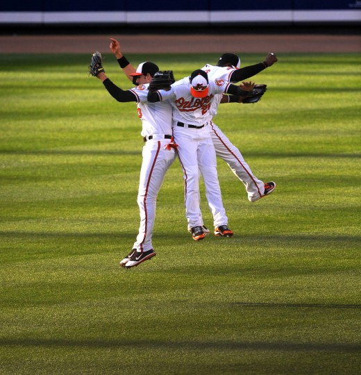Orioles Ryan Flaherty, Nick Markakis and Adam Jones do their outfield leap, as the celebrated Baltimore's 6-5 win over Texas. (Gene Sweeney Jr./Baltimore Sun)