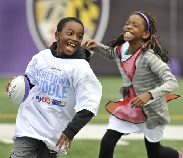 Mubarak Muhammed makes his way around a classmate during a game of capture the flag. About 100 local students from Dogwood Elementary test their physical endurance and ability to work as a team in order to complete various activities at M&T Bank Stadium as part of NFL Play 60 with the help of a few Baltimore Ravens' players. (Lloyd Fox/Baltimore Sun)