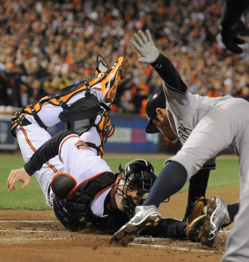 New York Yankees' Ichiro Suzuki touches the plate to score against Baltimore Orioles catcher Matt Wieters in the first inning during Game 2 of the American League Division Series at Oriole Park at Camden Yards in Baltimore. (Karl Merton Ferron/Baltimore Sun)