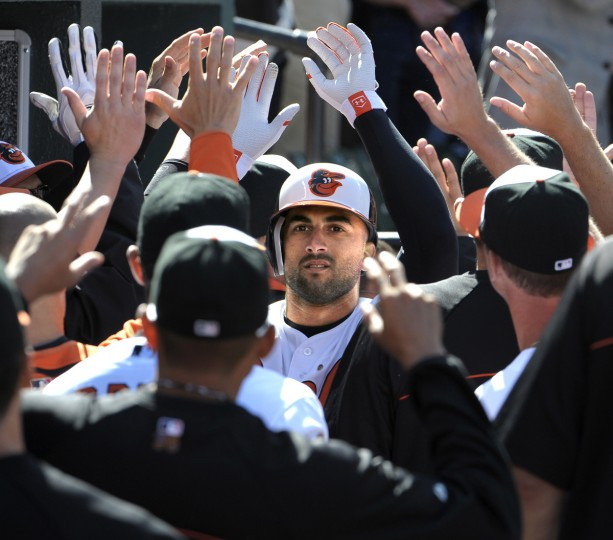 Nick Markakis receivies congratulations from his teammates after his 1st inning 2 run home run on Opening Day of the 2012 season against the Minnesota Twins. (Gene Sweeney Jr./Baltimore Sun)