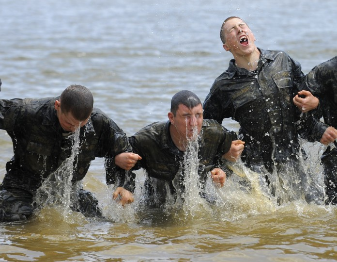 Members of the 10th company struggle through the Wet and Sandy drill at the Naval Academy during Navy Sea Trials. The event serves as a leadership challenge for the plebes. The freshman class go through 14 hours of physical and mental training. (Lloyd Fox/Baltimore Sun)