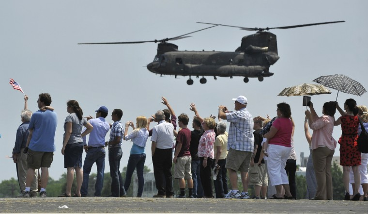 Chinook helicopters take off from Aberdeen during a deployment Ceremony for the B-3-126th GSAB which is an aviation unit of about 60 soldiers from the Maryland National Guard. They are being deployed to Afghanistan. The ceremony was held at the Aberdeen Proving Ground. (Lloyd Fox/Baltimore Sun)