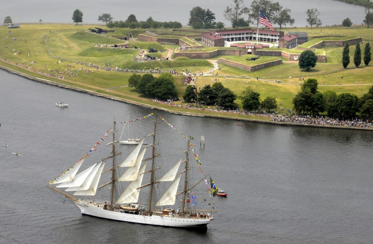 The NVe Cisne Branco from Brazil and dozens of other tall ships and naval vessels depart the Inner Harbor and pass by Fort McHenry, ending the Star Spangled Sailabration. (Algerina Perna/Baltimore Sun)