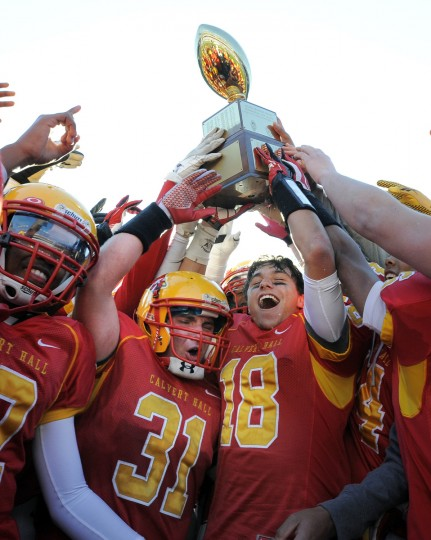 Calvert Hall #31 Robbie Jones and #18 Logan Kurek hold up the game winning trophy after defeating Loyola 21-14 in the 93rd Annual Turkey Bowl football game played at M&T Bank Stadium on Thanksgiving. (Lloyd Fox/Baltimore Sun)
