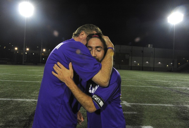 Kyle Kauffman, right, is hugged by head coach John Plevyak of Stevenson University after a 2-0 win over Hood College. Kyle Kauffman, the manager for Stevenson's soccer team, has cerebral palsy and had his dream come true by getting a chance to play in the match against Hood College. (Lloyd Fox/Baltimore Sun)