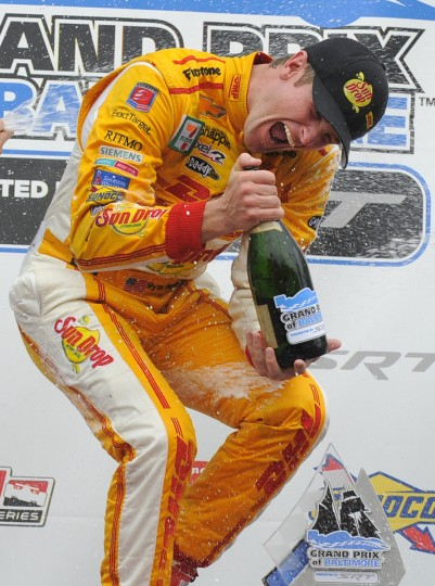 Grand Pix of Baltimore winner, Ryan Hunter-Reay, celebrates in the winner's circle after the race. (Lloyd Fox/Baltimore Sun)