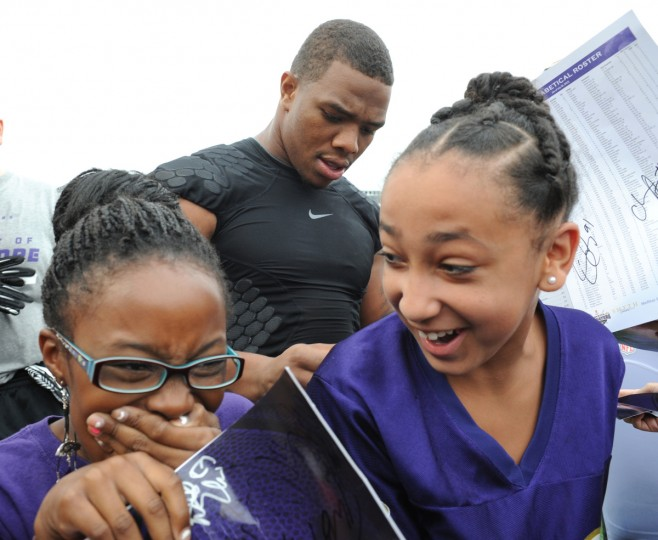 Jaida Franklin, 11, left, and her friend Skyia Cooley,11, both from Baltimore, are so excited to have Baltimore Ravens running back Ray Rice, center, give them autographs after the Ravens practice. The Baltimore Ravens have their final training camp practice away from the Under Armour Performance Center at Stevenson University. They sign autographs for the fans after practice. (Algerina Perna/Baltimore Sun)
