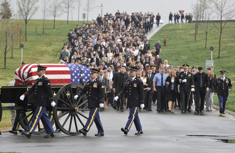 Family and friends follow the casket of Major Robert Marchanti II, who was killed in Afghanistan in February 2012, during his funeral service at the Arlington National Cemetery. (Lloyd Fox/Baltimore Sun)