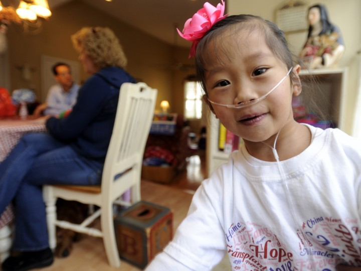 Ann and Ed Bartlinski have adopted five special-needs girls from China. They also have 4 biological children. This is five year old Teresa, who needs a heart transplant. (Barbara Haddock Taylor/Baltimore Sun)