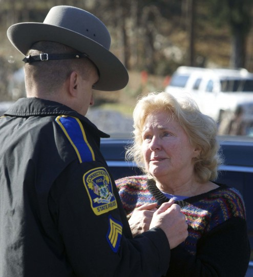 A woman speaks with a Connecticut State Trooper outside Sandy Hook Elementary School after a shooting in Newtown, Connecticut. A shooter opened fire at the elementary school in Newtown, Connecticut, on Friday, killing several people including children, the Hartford Courant newspaper reported. (Michelle McLoughlin/Reuters phto