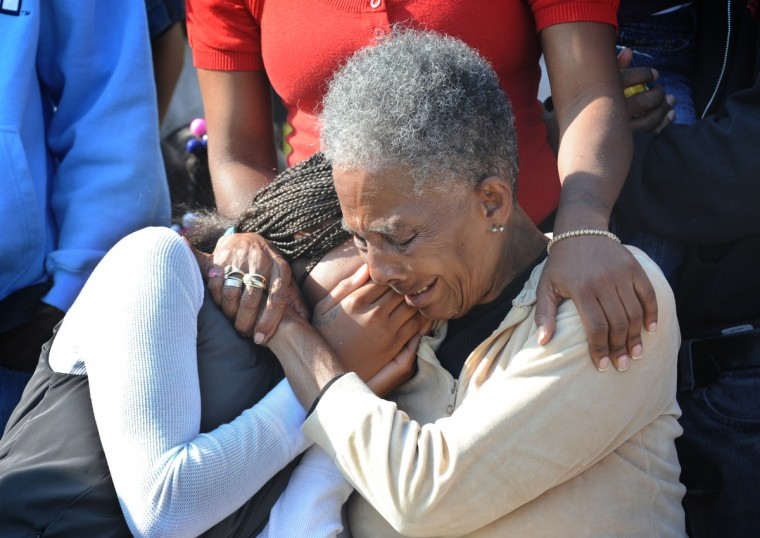 Jean Anderson, left, and her grandmother, Edith Fletcher, weep at a protest and press conference that was held at the corner of Montford Ave. and Biddle Streets protesting the death of Anthony Anderson Sr. while in police custody. Anderson, Sr. was Jean Anderson's father, and Edith Fletcher's son. (Algerina Perna/Baltimore Sun)