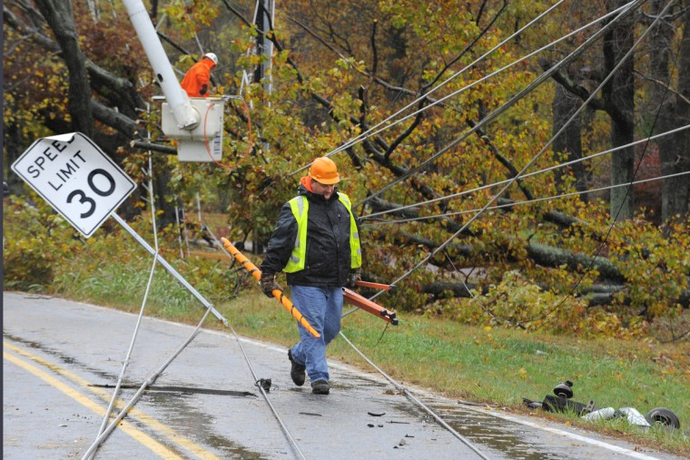 Asplundh Tree Expert Co. helps to get a large tree off of power lines on Schucks Road in Bel Air. Hurricane Sandy and the debris and water problems in Harford County. (Lloyd Fox/Sun Photographer)