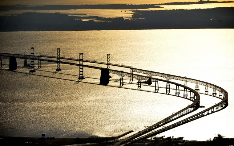 Golden morning light shimmers across the Chesapeake Bay and silhouettes the Bay Bridge. (Kim Hairston/Baltimore Sun)