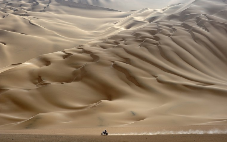 A lonesome motorcyclist rides across the desert during the stage 11 of the Dakar 2012, between Arica and Arequipa, Chile, on January 12, 2012. French Cyril Despres won stage 11. (Philippe Desmazes/Getty Images)