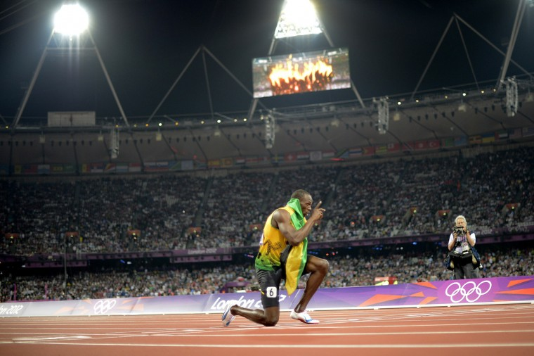 Jamaica's Usain Bolt celebrates after Jamaica won and set a new world record in the men's 4X100 relay final at the athletics event of the London 2012 Olympic Games on August 11, 2012 in London. (Adrian Dennis/Getty Images)
