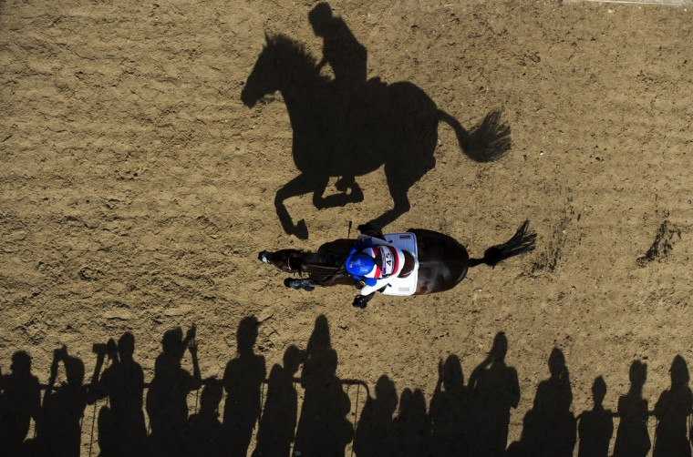 Thailand's Nina Lamsan Ligon riding Butts Leon rides past spectators as she competes in the Cross Country phase of the Eventing competition of the 2012 London Olympics at the Equestrian venue in Greenwich Park, London, July 30, 2012. (Adrian Dennis/Getty Images)