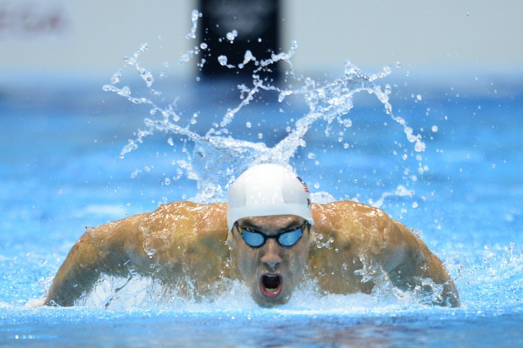 US swimmer Michael Phelps competes in the men's 200m butterfly heats swimming event at the London 2012 Olympic Games at the Olympic Park in London on July 30, 2012. (Leon Neal/Getty Images)