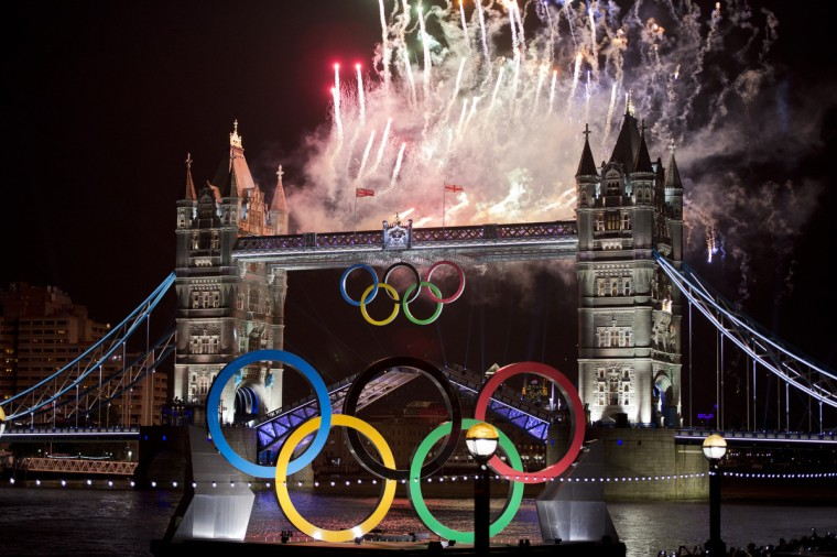 Fireworks explode above Tower Bridge in London on July 27, 2012, to celebrate the opening of the London 2012 Olympic Games. (Johannes Eisele/Getty Images)