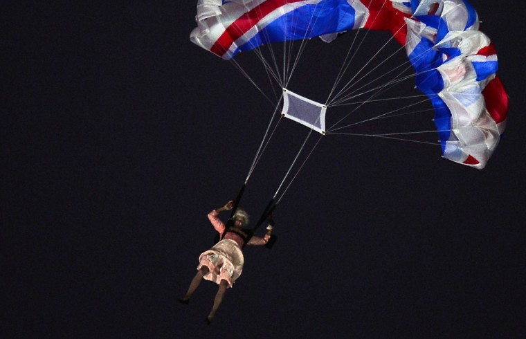 An actor dressed to resemble Britain's Queen Elizabeth II parachutes into the stadium during the opening ceremony of the London 2012 Olympic Games at the Olympic Stadium in London on July 27, 2012. (Oliver Morin/Getty Images)