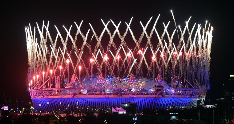 Fireworks light up the Olympic Stadium during the opening ceremony of the London 2012 Olympic Games in London on July 28, 2012. (Indranil Mukherjee/Getty Images)