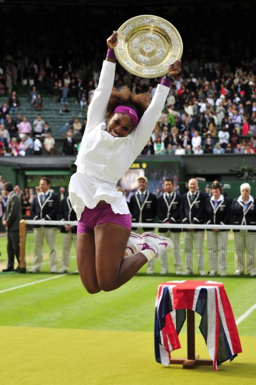 US player Serena Williams celebrates with the trophy, the Venus Rosewater Dish after her women's singles final victory over Poland's Agnieszka Radwanska on day 12 of the 2012 Wimbledon Championships tennis tournament at the All England Tennis Club in Wimbledon, southwest London, on July 7, 2012. Serena Williams won the match 6-1, 5-7, 6-2. (Glyn Kirk/Getty Images)