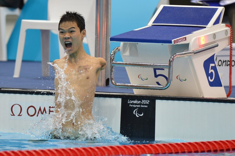 China's Zheng Tao celebrates breaking the world record after winning the men's 100m backstroke - S6 swimming event during the London 2012 Paralympic Games at the Olympic Park Aquatics Centre in east London on August 30, 2012. (Ben Stansall/Getty Images)