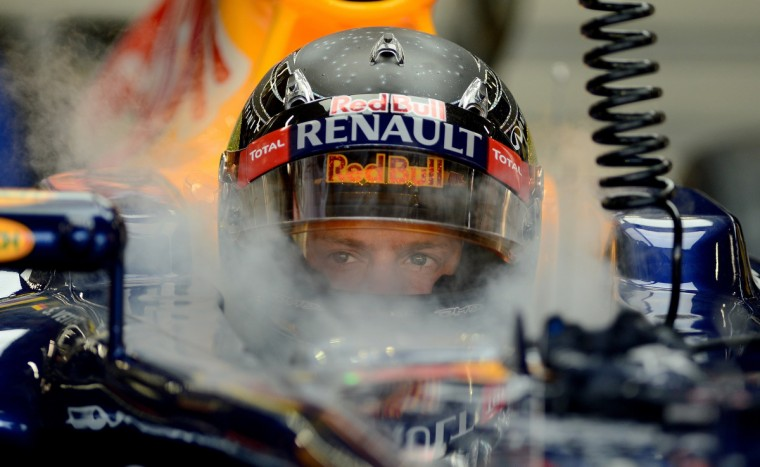 Red Bull Renault driver Sebastian Vettel of Germany sits in his Formula One race car during the first practice session of Formula One's Singapore Grand Prix in Singapore on September 21, 2012. (Punit ParanjpeGetty Images)