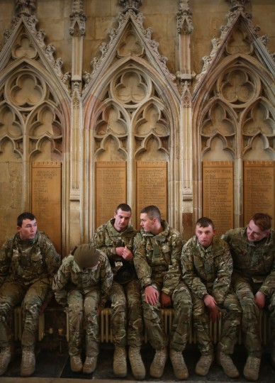 Soldiers from 3rd Battalion Yorkshire Regiment warm themselves on the radiators of York Minster during a homecoming service in York, England. Soldiers from the 3rd Battalion Yorkshire Regiment marched through the City of York before attending a thanksgiving and remembrance service at York Minster. The soldiers have recently completed a six-month tour of duty in Afghanistan where they lost seven comrades including six in one Taliban attack. (Christopher Furlong/Getty Images)