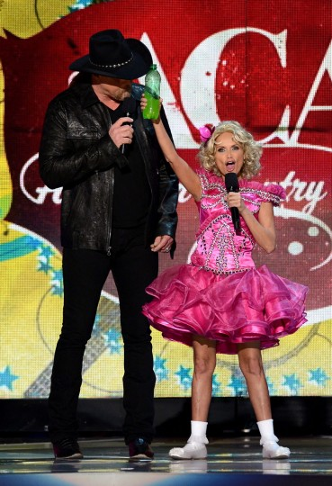 Hosts Trace Adkins and Kristin Chenoweth speak onstage during the 2012 American Country Awards at the Mandalay Bay Events Center in Las Vegas, Nevada. (Mark Davis/Getty Images)