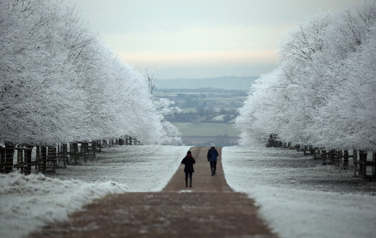 People are seen out for a walk as frost lingers on the trees at Dyrham Park on December 12, 2012 near Bath, England. Forecasters have warned that the UK could experience the coldest day of the year so far today, with temperatures dropping as low as -14C, bringing widespread ice, harsh frosts and freezing fog. Travel disruption is expected with warnings for heavy snow in some parts of the country. (Matt Cardy/Getty Images)