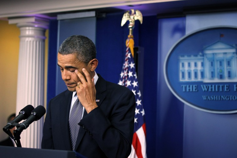 U.S. President Barack Obama pauses as he makes a statement in response to the elementary school shooting in Connecticut at the White House in Washington, DC. (Alex Wong/Getty Images)