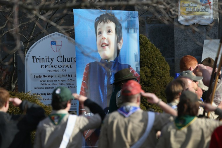 Boy scouts salute as a funeral procession for Benjamin Wheeler, 6, enters the Trinity Episcopal Church on December 20, 2012 in Newtown, Connecticut. Benjamin, a member of Tiger Scout Den 6, was killed when 20 children and six adults were massacred at Sandy Hook Elementary School last Friday. (John Moore/Getty Images)