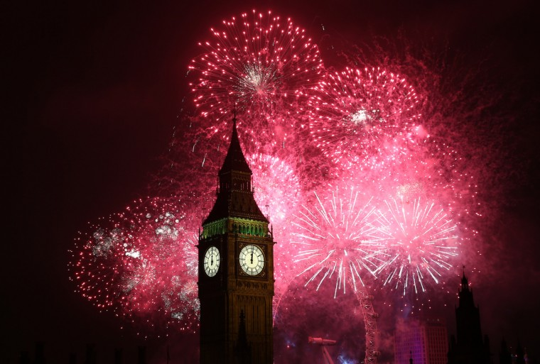 Fireworks light up the London skyline and Big Ben just after midnight in London, England. Thousands of people are lining the banks of the River Thames near Parliament in central London to herald the start of 2013. (Peter Macdiarmid/Getty Images)