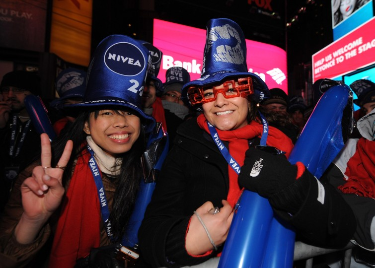 Revelers in Times Square on New Year's Eve get festive with NIVEA accessories and products at Times Square in New York City. (Brad Barket/Getty Images)