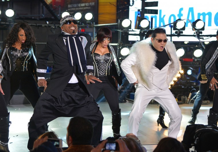 Rapper MC Hammer (L), and Korean Rapper PSY perform during New Year's Eve 2013 In Times Square at Times Square in New York City. (Mike Coppola/Getty Images)