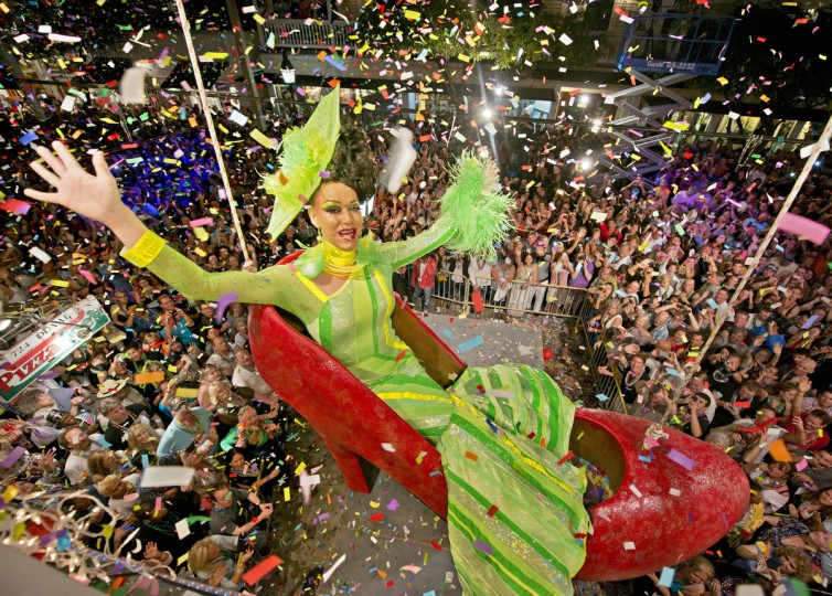 Gary Marion, portraying female impersonator Sushi, hangs in an oversized replica of a woman's red high heel shoe over Duval Street at the Bourbon Street Pub Complex in Key West, Florida. The Red Shoe Drop has become a Key West tradition and is one of five Florida Keys warm-weather takeoffs on New York City's Times Square ball drop marking the beginning of the new year. (Andy Newman/Florida Keys News Bureau via Getty Images)
